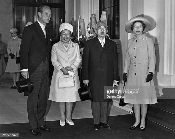 Emperor Hirohito and Empress Nagako of Japan pose with Queen Elizabeth II and Prince Philip at Buckingham Palace, at the start of a three-day visit...