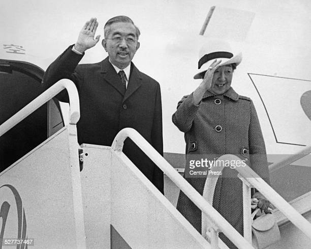 Emperor Hirohito and Empress Nagako of Japan wave goodbye at London's Heathrow Airport at the end of their three-day visit to the UK, 8th October...
