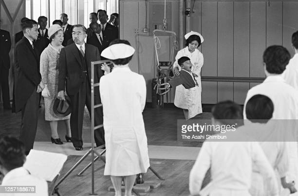 Emperor Hirohito and Empress Nagako watch rehabilitation exercise of physically handicapped children at Tottori Prefecture Seishi Gakuen on May 9,...