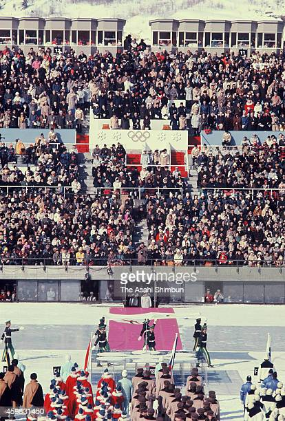 Emperor Hirohito and Empress Nagako watch the opening ceremony of the 1972 Sapporo Winter Olympics at Makomanai Open Stadium on February 3 1972 in...