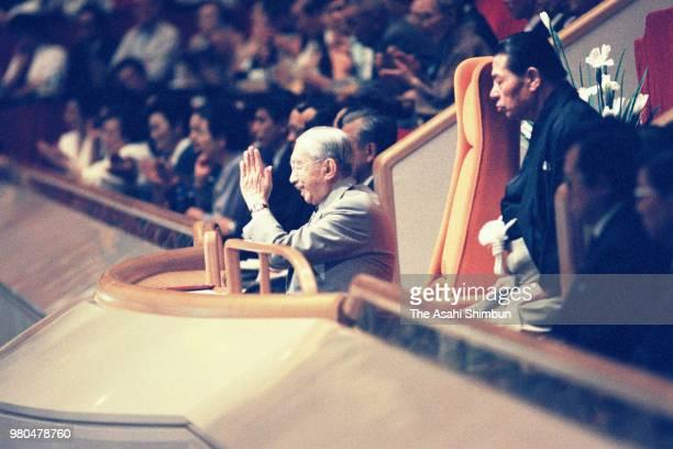 Emperor Hirohito enjoys sumo bouts on day seven of the Grand Sumo Summer Tournament at Ryogoku Kokugikan on May 16 1987 in Tokyo Japan