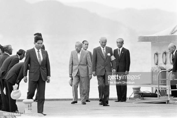 Emperor Hirohito gets off from a sightseeing cruise at Lake Inawashiro during his trip to celebrate the diamond wedding with Empress Nagako on...