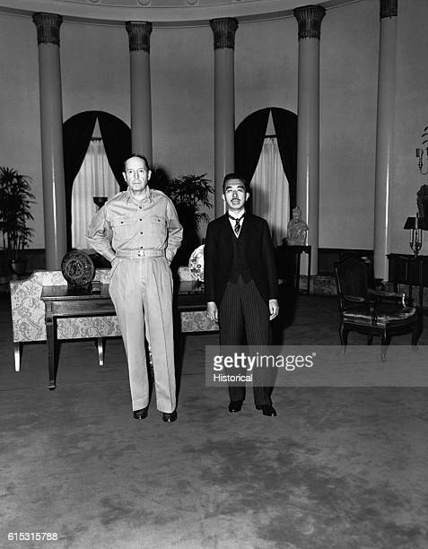 Emperor Hirohito is received by General Douglas MacArthur US commander of the Japanese occupation at the US embassy in Tokyo The Emperor is attired...