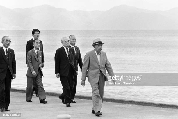Emperor Hirohito is seen after a sightseeing cruise at Lake Inawashiro during his trip to celebrate the diamond wedding with Empress Nagako on...