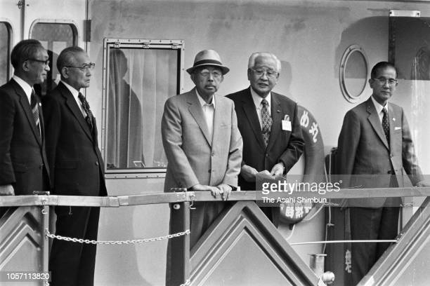 Emperor Hirohito is seen on a sightseeing cruise at Lake Inawashiro during his trip to celebrate the diamond wedding with Empress Nagako on September...