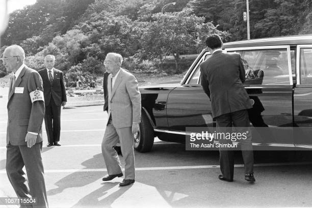 Emperor Hirohito is seen on arrival at Lake Inawashiro to get a sightseeing cruise during his trip to celebrate the diamond wedding with Empress...