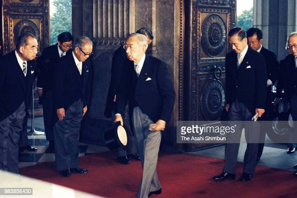Emperor Hirohito is seen on arrival at the Diet building to attend the opening ceremony of the 109th Extraordinary session on July 6 1987 in Tokyo...