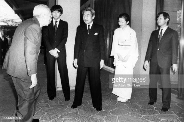Emperor Hirohito is welcomed by Crown Prince Akihito Crown Princess Michiko Prince Naruhito and Prince Fumihito for a dinner to celebrate the...