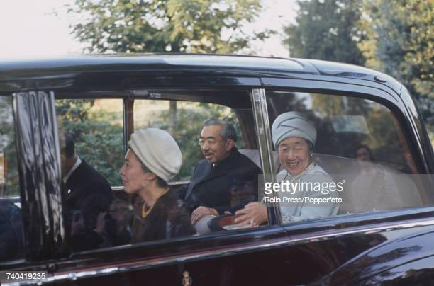 Emperor Hirohito of Japan and his wife Empress Kojun pictured sitting in the rear of a limousine as they visit Kew Gardens in London in October 1971...