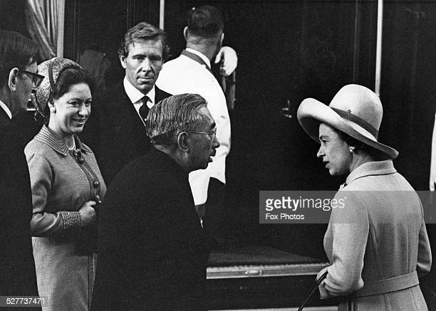 Emperor Hirohito of Japan arrives in London at the start of his four-day State Visit, 5th October 1971. Here he chats with Queen Elizabeth II at...
