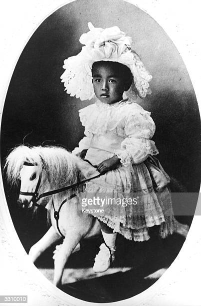 Emperor Hirohito of Japan as a young child riding on his rockinghorse