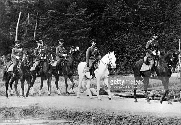 Emperor Hirohito of Japan, mounted on his favorite white horse, 'Snow Drift,' as he directed the annual war maneuvers in western Japan, Fukui...