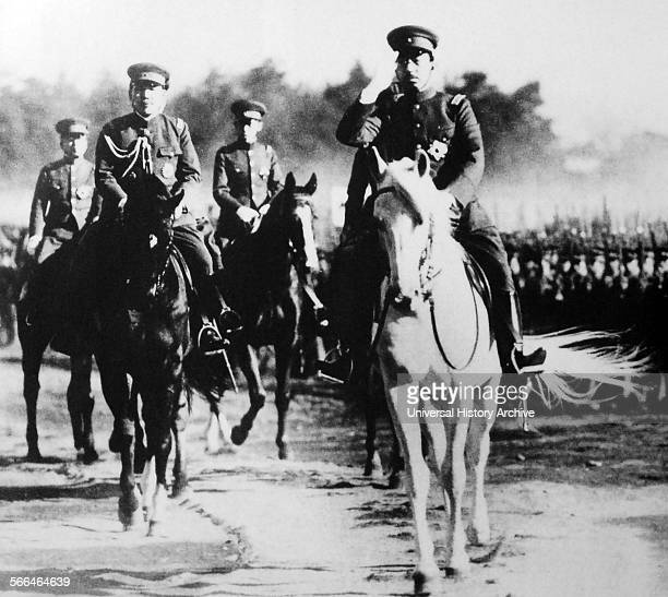 Emperor Hirohito of Japan on horseback reviewing troops of the Japanese Army 1938