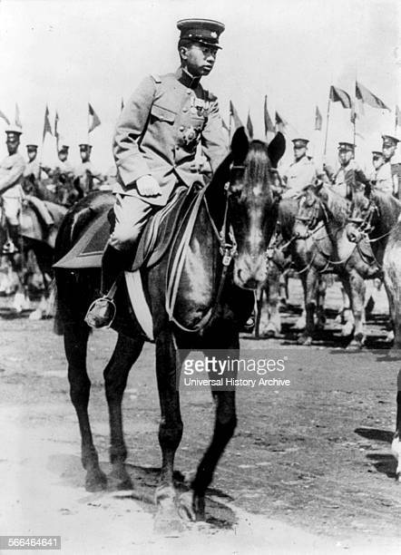 Emperor Hirohito of Japan on horseback reviewing troops of the Japanese Army 1928