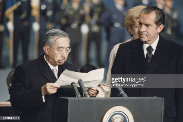 Emperor Hirohito of Japan pictured on left beside President of the United States Richard Nixon as he reads a prepared speech during a stop off visit...