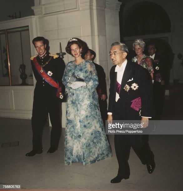 Emperor Hirohito of Japan pictured on right with King Baudouin of Belgium and Queen Fabiola of Belgium of the Belgian royal family at a state dinner...