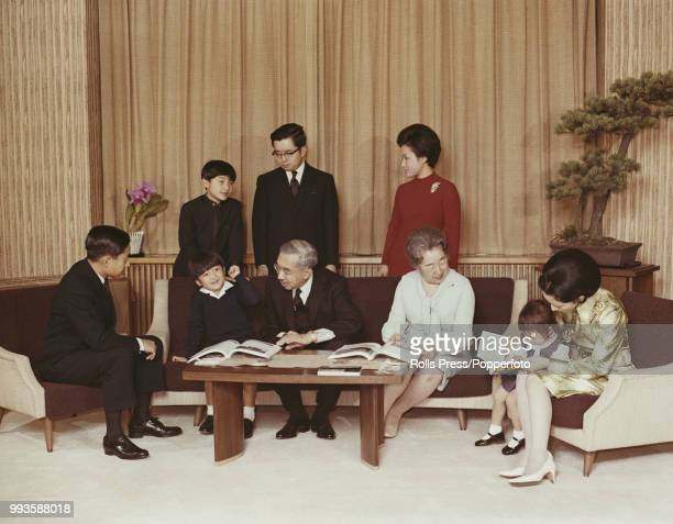 Emperor Hirohito of Japan pictured seated in centre with members of the Imperial family in Tokyo Japan in December 1971 Family members are back row...