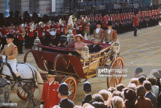 Emperor Hirohito of Japan rides with Queen Elizabeth II in an open carriage to Buckingham Palace, at the start of a three-day visit to London on 5th...