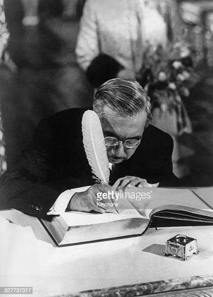 Emperor Hirohito of Japan signs the 'livre d'or' or visitors' book during a reception at the town hall in Brussels, Belgium, 1st October 1971.