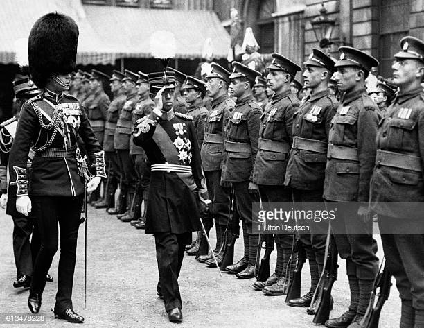 Emperor Hirohito of Japan when he was Crown Prince inspects a Guard of Honour of First World War veterans at London's Guildhall in 1921 during his...
