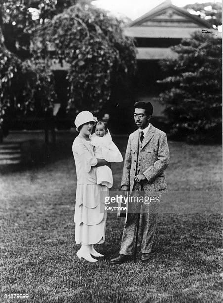 Emperor Hirohito of Japan with his baby daughter Princess Shigeko and Crown Princess Nagako, December 1925.