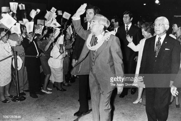 Emperor Hirohito waves to wellwishers on arrival at Honolulu Airport on October 10 1975 in Honolulu Hawaii