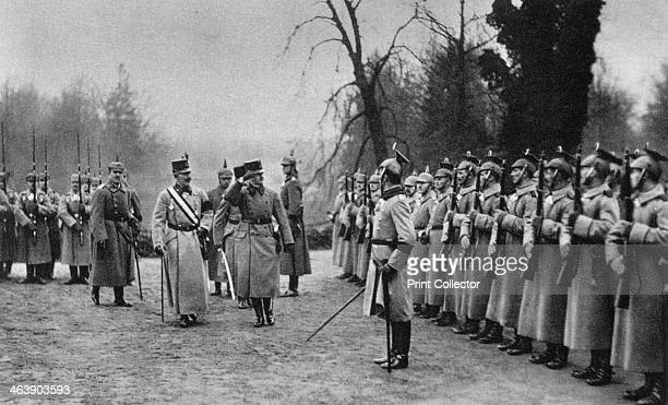 Emperor Karl I of Austria visiting Kaiser Wilhelm II at Army headquarters, World War I, 1917. Both Emperors salute the guard of honor. A photograph...