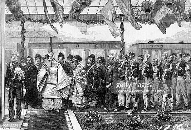 Emperor Meiji and a party of Japanese and British dignitaries arriving at Yokohama railway station to mark the opening of the first permanent railway...