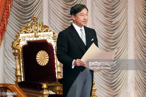 Emperor Naruhito addresses during the opening ceremony at the Upper House of the parliament on October 4, 2019 in Tokyo, Japan. The 200th...
