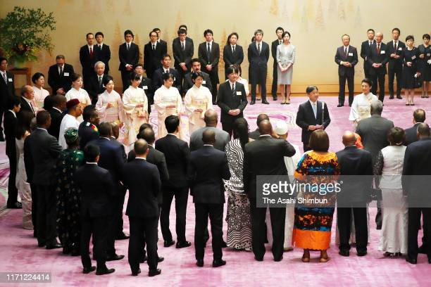 Emperor Naruhito addresses while Empress Masako and royal family members listen at the tea party inviting African leaders at the Imperial Palace on...