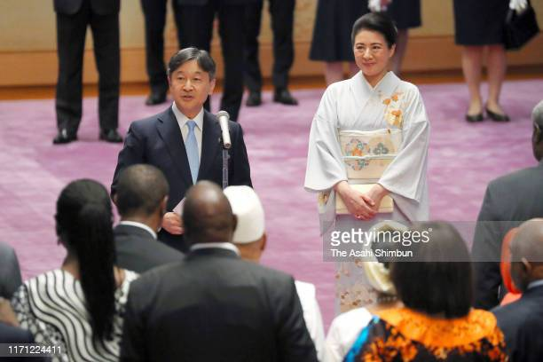 Emperor Naruhito addresses while Empress Masako listens at the tea party inviting African leaders at the Imperial Palace on August 30, 2019 in Tokyo,...