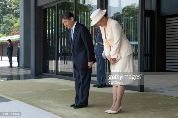 Emperor Naruhito and Empress Masako bow as US President Donald Trump and First Lady Melania Trump leave the Imperial Palace on May 27 2019 in Tokyo...