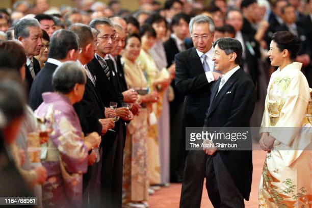 Emperor Naruhito and Empress Masako talk with guests during the 'KyoennoGi' banquet celebrating the enthronement at the Imperial Palace on October 31...