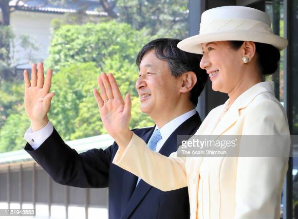 Emperor Naruhito and Empress Masako wave as U.S President Donald Trump and First Lady Melania Trump leave the Imperial Palace after the welcome...
