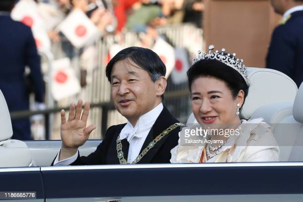 Emperor Naruhito and Empress Masako wave from their car during the imperial parade for enthronement of Emperor Naruhito on November 10, 2019 in...