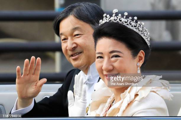 Emperor Naruhito and Empress Masako wave from their car during the imperial parade for enthronement of Emperor Naruhito on November 10 2019 in Tokyo...