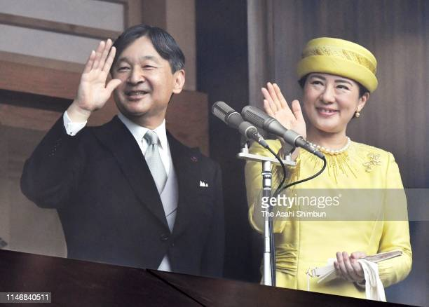 Emperor Naruhito and Empress Masako wave to wellwishers after making a public speech on the balcony of the Imperial Palace on May 4 2019 in Tokyo...