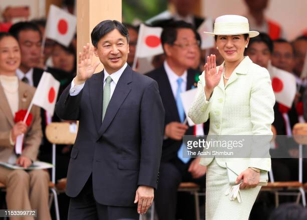 Emperor Naruhito and Empress Masako wave to well-wishers after attending the National Tree Planting Festival at the Aichi Prefectural Forest Park on...