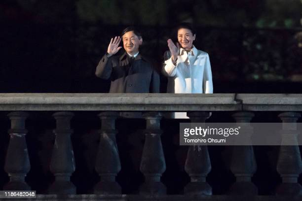 Emperor Naruhito and Empress Masako wave to well-wishers during the National Festival to Celebrate the Throne of New Emperor at the Imperial Palace...