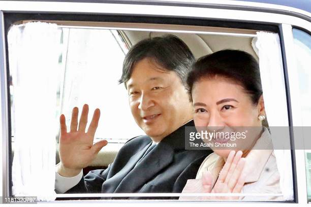 Emperor Naruhito and Empress Masako wave to well-wishers on arrival at the Imperial Palace on October 15, 2019 in Tokyo, Japan.