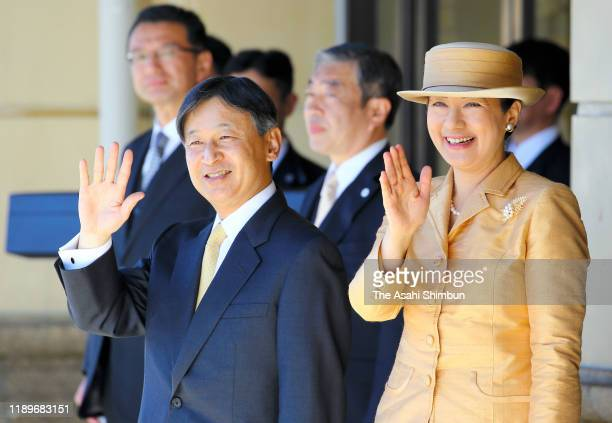 Emperor Naruhito and Empress Masako wave to well-wishers on departure at Uji Yamada Station after visiting the Ise Shrine on November 23, 2019 in...