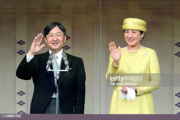 Emperor Naruhito and Empress Masako wave to wellwishers on the balcony of the Imperial Palace on May 4 2019 in Tokyo Japan