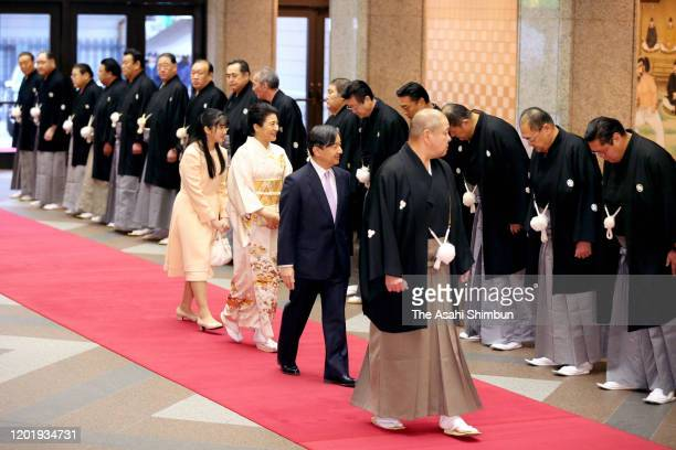 Emperor Naruhito, Empress Masako and Princess Aiko are seen on arrival on day fourteen of the Grand Sumo New Year tournament at Ryogoku Kokugikan on...