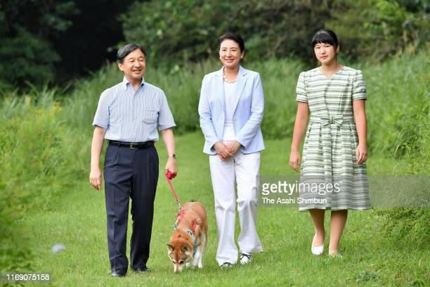 Emperor Naruhito, Empress Masako and Princess Aiko stroll with their dog Yuri at the Nasu Imperial Villa on August 19, 2019 in Nasu, Tochigi, Japan.