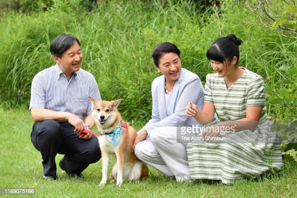 Emperor Naruhito Empress Masako and Princess Aiko stroll with their dog Yuri at the Nasu Imperial Villa on August 19 2019 in Nasu Tochigi Japan