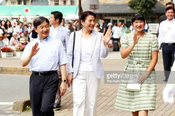 Emperor Naruhito, Empress Masako and Princess Aiko wave to well-wishers at Nasushiobara Station on their way to the Nasu Imperial Villa on August 19,...