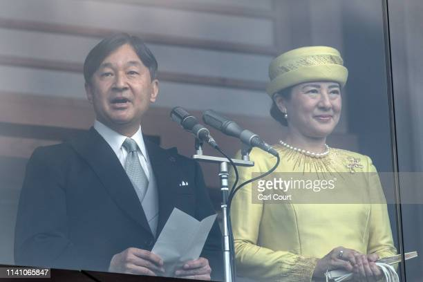 Emperor Naruhito of Japan accompanied by his wife Empress Masako makes a speech from the balcony of the Imperial Palace on May 4 2019 in Tokyo Japan...