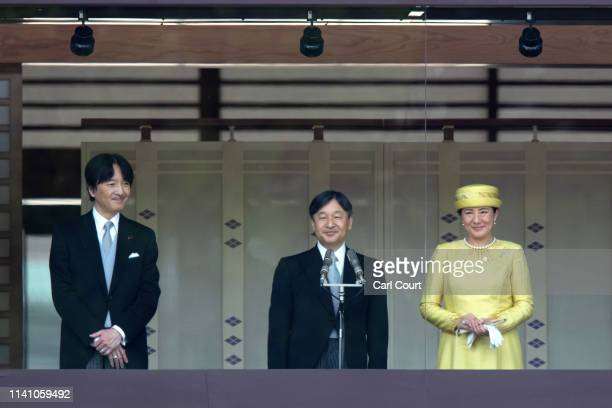 Emperor Naruhito of Japan addresses members of the public from the balcony of the Imperial Palace as his wife Empress Masako and brother Fumihito...