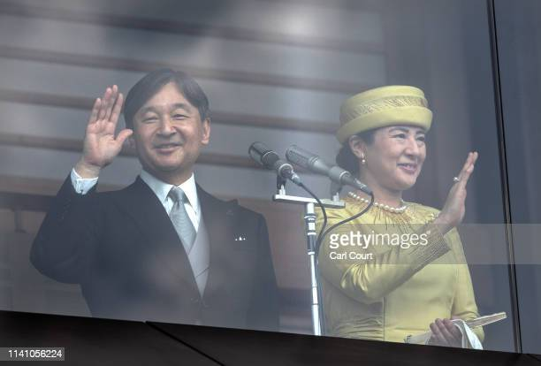 Emperor Naruhito of Japan and as his wife Empress Masako wave to the public from the balcony of the Imperial Palace on May 4 2019 in Tokyo Japan...