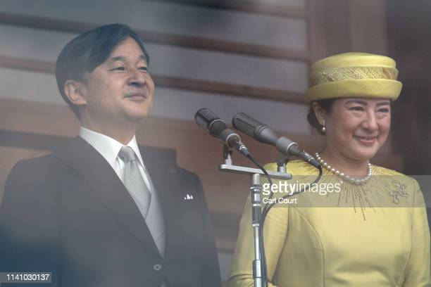 Emperor Naruhito of Japan and his wife Empress Masako address members of the public from the balcony of the Imperial Palace on May 4 2019 in Tokyo...